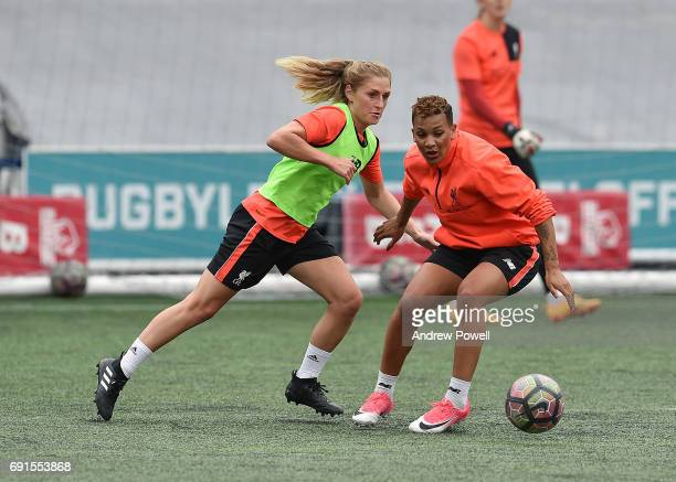 Laura Coombs and Shanice Van De Sanden of Liverpool Ladies during a training session at Select Security Stadium on June 2 2017 in Widnes England