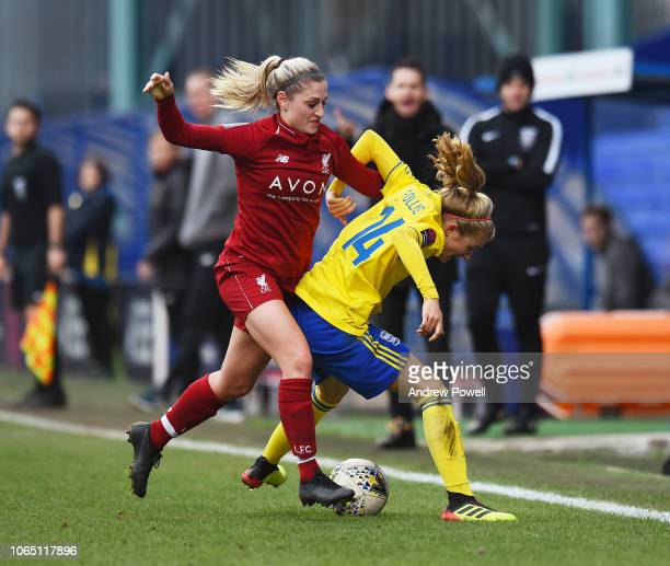 Laura Coombs of Liverpool Women competes with Emma Follis of Birmingham City Women during the Womens Super League match between Liverpool Women and...