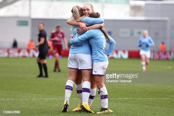 Laura Coombs of Manchester City celebrates her goal with teammates during the Women's FA Cup game between Manchester City and Ipswich FC at The...
