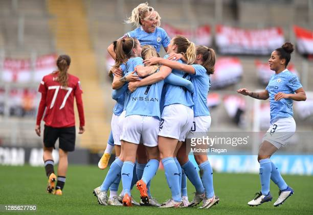 Laura Coombs of Manchester City celebrates with her team mates after scoring her team's second goal during the Barclays FA Women's Super League match...