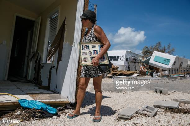 Laura Costello peers into her home that was ripped apart by Hurricane Irma at the Sea Breeze trailer park in Islamorada Florida Keys on Sept 12 2017