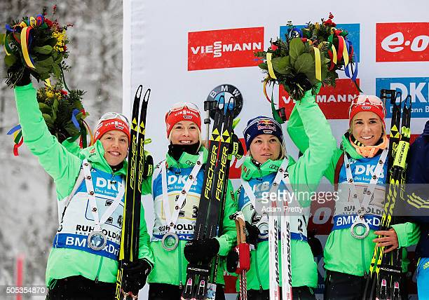 Laura Dahlmeier Maren Hammerschmidt Mirian Goessner and Karolin Horchler of Germany celebrate second place on the podium after the Women's 4x 6km...