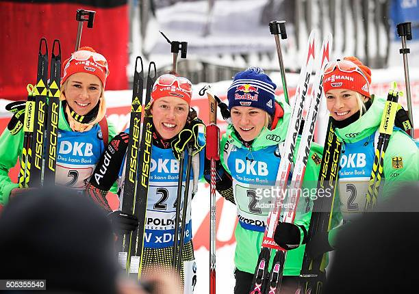 Laura Dahlmeier Maren Hammerschmidt Mirian Goessner and Karolin Horchler of Germany celebrate second place after the Women's 4x 6km relay on Day 5 of...