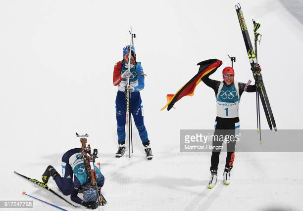 Laura Dahlmeier of Germany Anastasiya Kuzmina of Slovakia and Anais Bescond of France react after crossing the finish line during the Women's...