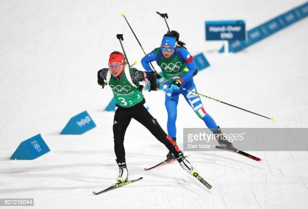 Laura Dahlmeier of Germany and Dorothea Wierer of Italy compete during the Biathlon 2x6km Women 2x75km Men Mixed Relay on day 11 of the PyeongChang...