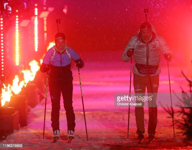 Laura Dahlmeier of Germany and Philipp Nawrath of Germany enter the Arena prior to the Biathlon World Team Challenge at Veltins Arena on December 28,...