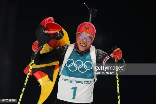 Laura Dahlmeier of Germany celebrates after crossing the finish line during the Women's Biathlon 10km Pursuit on day three of the PyeongChang 2018...