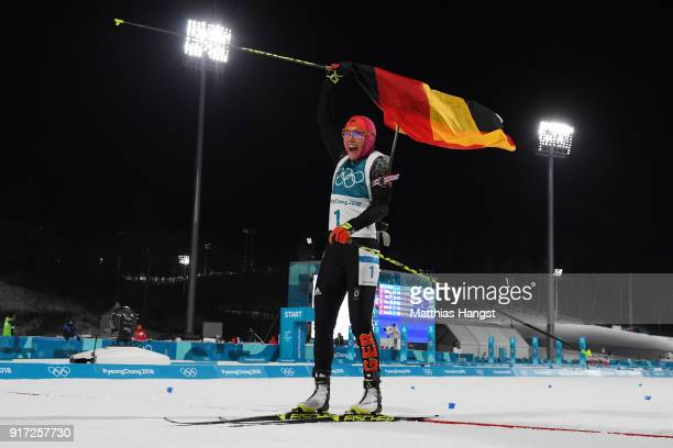 Laura Dahlmeier of Germany celebrates her time after crossing the finish line during the Women's Biathlon 10km Pursuit on day three of the...