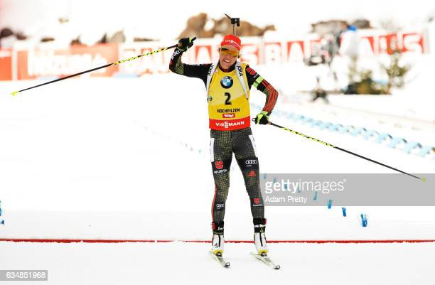 Laura Dahlmeier of Germany celebrates victory in the women's 10km pursuit competition of the IBU World Championships Biathlon 2017 at the Biathlon...