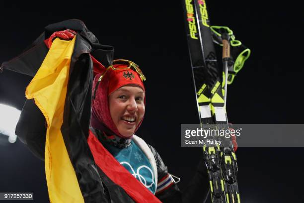 Laura Dahlmeier of Germany celebrates winning the gold medal during the Women's Biathlon 10km Pursuit on day three of the PyeongChang 2018 Winter...