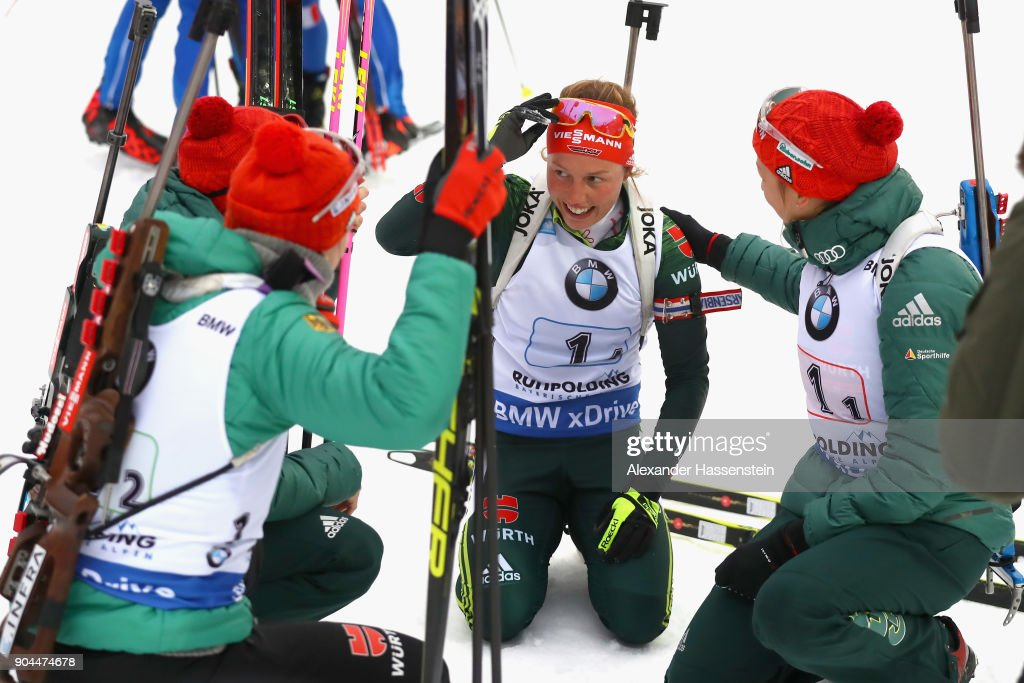 Laura Dahlmeier (C) of Germany celebrates winning the women's 6km relay with her team mates at the finish area competition during the IBU Biathlon World Cup at Chiemgau Arena on January 13, 2018 in Ruhpolding, Germany.