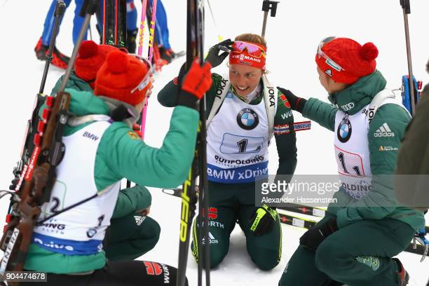 Laura Dahlmeier of Germany celebrates winning the women's 6km relay with her team mates at the finish area competition during the IBU Biathlon World...