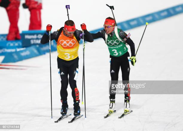 Laura Dahlmeier of Germany completes the second leg as teammate Arnd Peiffer of Germany begins the third during the Biathlon 2x6km Women 2x75km Men...