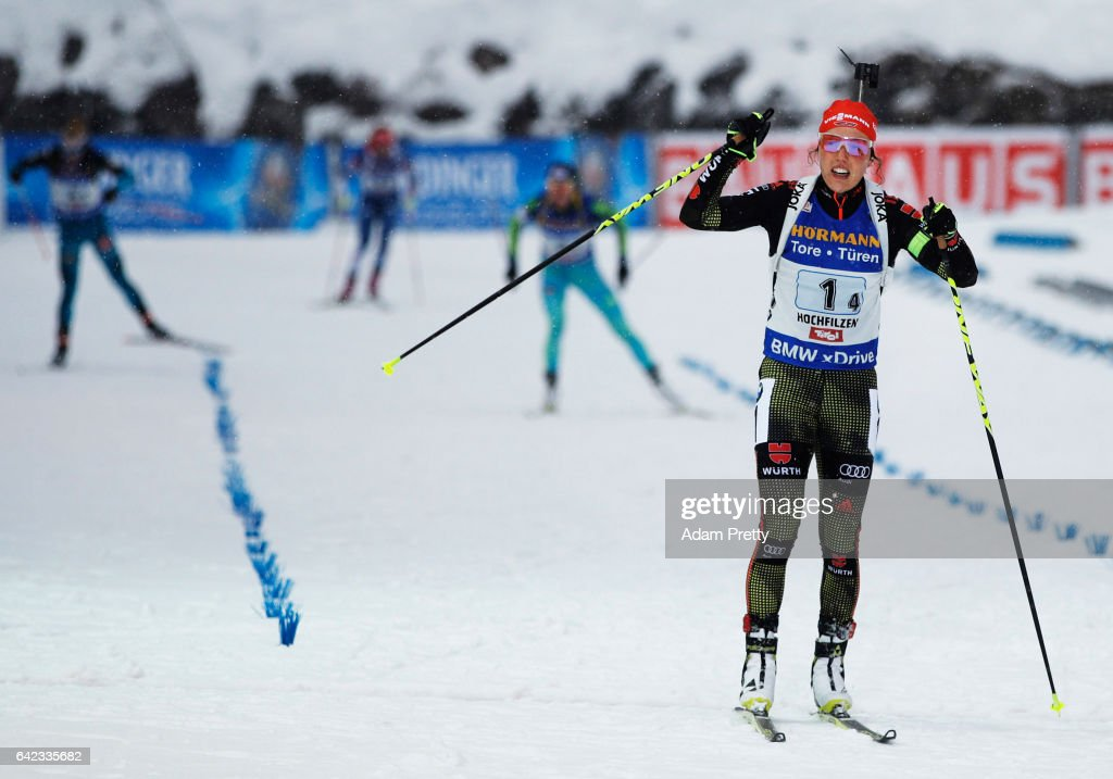 Laura Dahlmeier of Germany crosses the line to claim victory with Vanessa Hinz, Maren Hammerschmidt and Franziska Hildebrand of Germany in the Women's 4x 6km relay competition of the IBU World Championships Biathlon 2017 at the Biathlon Stadium Hochfilzen on February 17, 2017 in Hochfilzen, Austria.