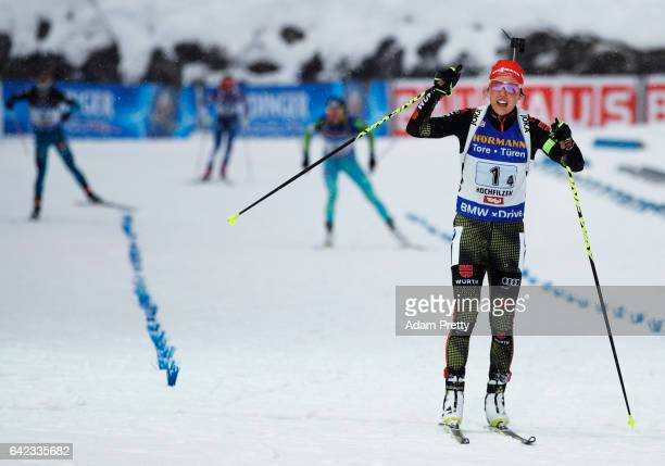 Laura Dahlmeier of Germany crosses the line to claim victory with Vanessa Hinz, Maren Hammerschmidt and Franziska Hildebrand of Germany in the...