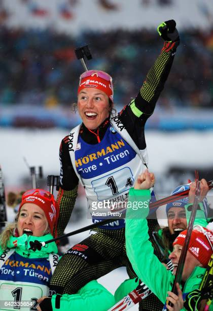 Laura Dahlmeier of Germany is held aloft by her team mates Vanessa Hinz, Maren Hammerschmidt and Franziska Hildebrand of Germany after victory in the...