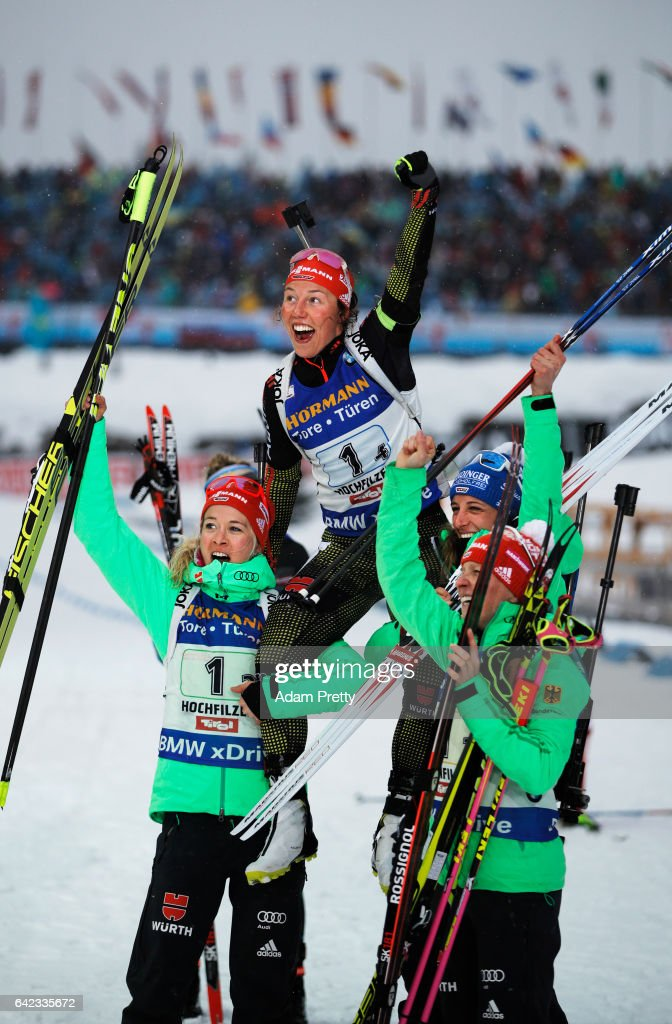Laura Dahlmeier of Germany is held aloft by her team mates Vanessa Hinz, Maren Hammerschmidt and Franziska Hildebrand of Germany after victory in the Women's 4x 6km relay competition of the IBU World Championships Biathlon 2017 at the Biathlon Stadium Hochfilzen on February 17, 2017 in Hochfilzen, Austria.