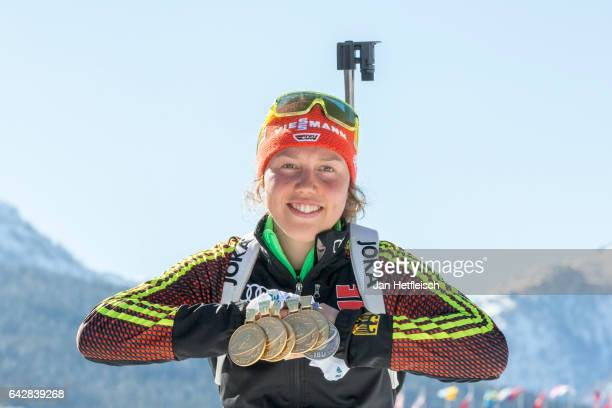 Laura Dahlmeier of Germany poses for a picture with her five medals of the IBU World Championships Biathlon 2017 at the Biathlon Stadium Hochfilzen...