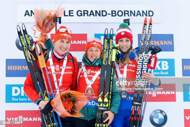 Laura Dahlmeier of Germany takes 1st place, Anastasiya Kuzmina of Slovakia takes 2nd place, Lisa Vittozzi takes 3rd place during the IBU Biathlon...
