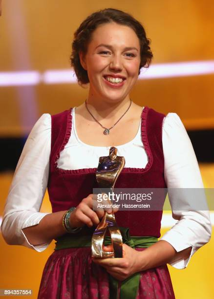 Laura Dahlmeier poses with the 'Sportler des Jahres 2017' award during the 'Sportler des Jahres 2017' Gala at Kurhaus BadenBaden on December 17 2017...