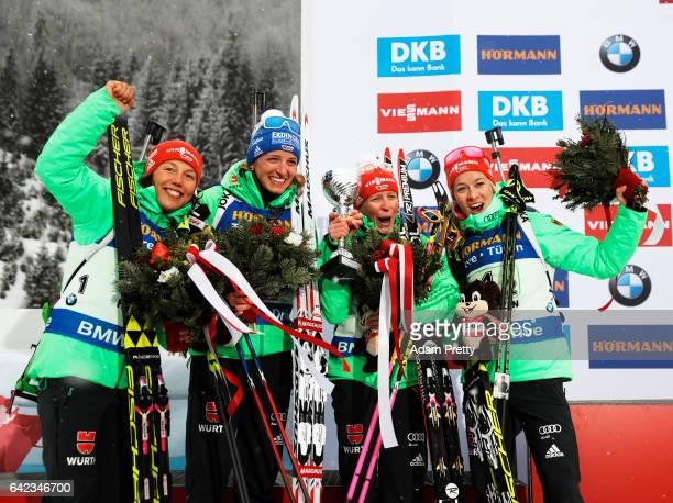 Laura Dahlmeier, Vanessa Hinz, Maren Hammerschmidt and Franziska Hildebrand of Germany celebrate after victory in the Women's 4x 6km relay...
