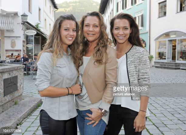 Laura , daughter of Hansi Hinterseer, his wife Romana and his daughter Jessica pose in front of the Filmtheater in Kitzbuehel, Austria, 20 October...