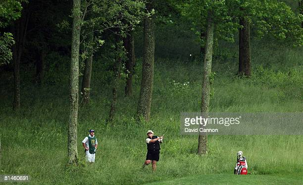 Laura Davies of England hits her second shot at the 6th hole from the deep rough during the first round of the 2008 McDonald's LPGA Championship held...