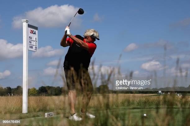 Laura Davies of England plays a tee shot on the fourth hole during the final round of the US Senior Women's Open at Chicago Golf Club on July 15 2018...