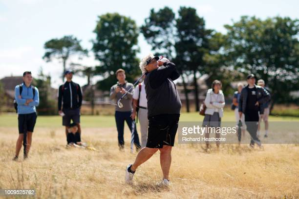Laura Davies of England plays her second shot from the rough on the 4th hole during day one of Ricoh Women's British Open at Royal Lytham St Annes on...