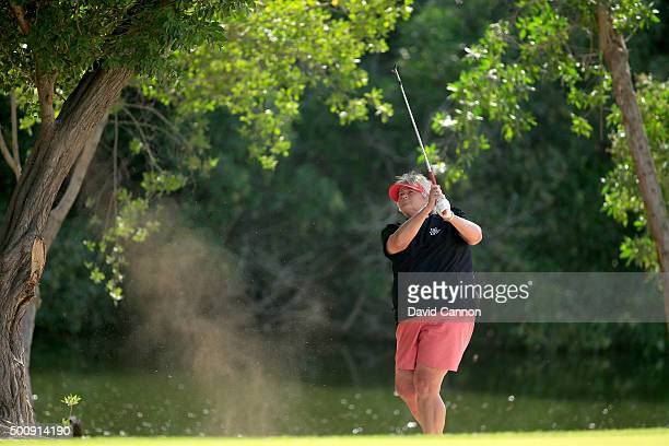 Laura Davies of England plays her second shot on teh par 4, second hole during the third round of the 2015 Omega Dubai Ladies Masters on the Majlis...
