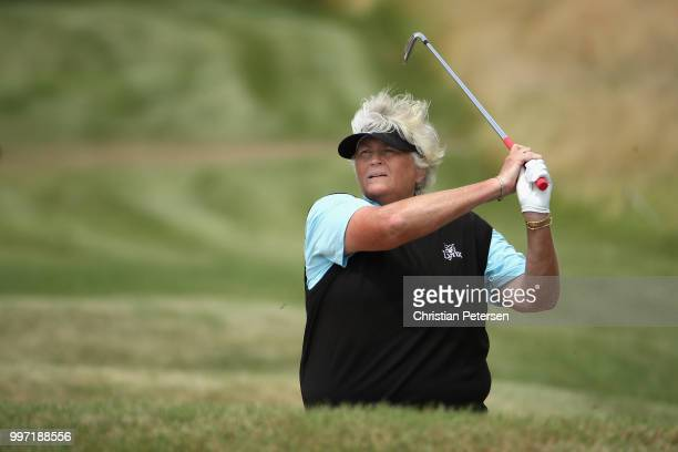 Laura Davies of England plays her second shot on the 15th hole during the first round of the US Senior Women's Open at Chicago Golf Club on July 12...