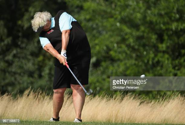 Laura Davies of England plays her second shot on the eighth hole during the first round of the US Senior Women's Open at Chicago Golf Club on July 12...