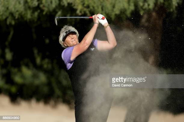 Laura Davies of England plays her second shot on the par 4 14th hole during the first round of the 2017 Dubai Ladies Classic on the Majlis Course at...