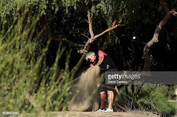 Laura Davies of England plays her second shot on the par 5, 13th hole during the delayed second round of the 2016 Omega Dubai Ladies Masters on the...