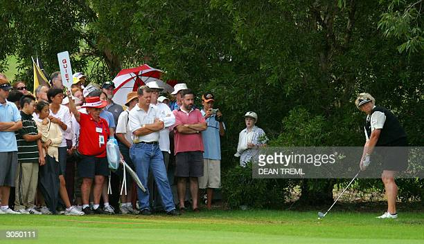 Laura Davies of England prepares to play a shot from the rough while the gallery watches on the eigth hole on day four of the AAMI Woman's Australian...