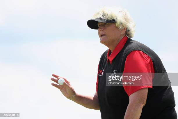 Laura Davies of England reacts after her putt on the 17th green during the final round of the US Senior Women's Open at Chicago Golf Club on July 15...