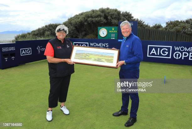 Laura Davies of England receives a gift from R&A Chief Executive Martin Slumbers to commemorate her 40th appearance at the Women's Open Championship...