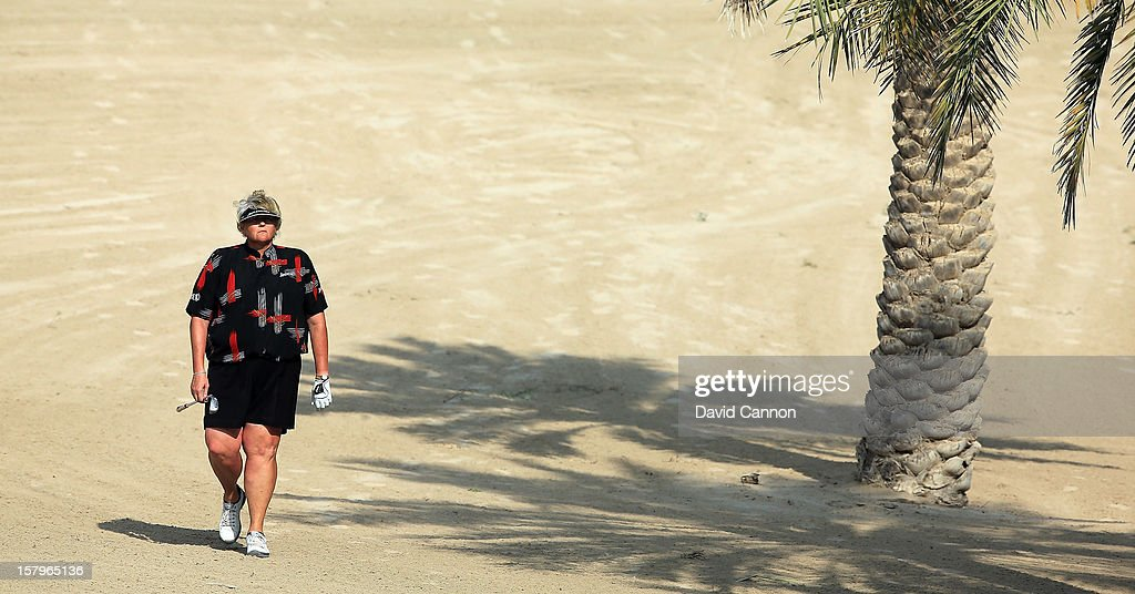 Laura Davies of England walks to her second shot at the par 4, 14th hole during the final round of the 2012 Omega Dubai Ladies Masters on the Majilis Course at the Emirates Golf Club on December 8, 2012 in Dubai, United Arab Emirates.