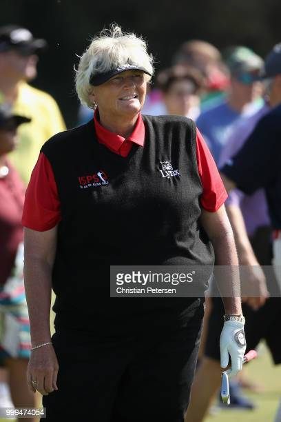 Laura Davies of England watches her second shot on the second hole during the final round of the US Senior Women's Open at Chicago Golf Club on July...