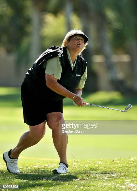 Laura Davies of England watches her shot from the rough on the 15th hole during the first round of the Kraft Nabisco Championship at Mission Hills...