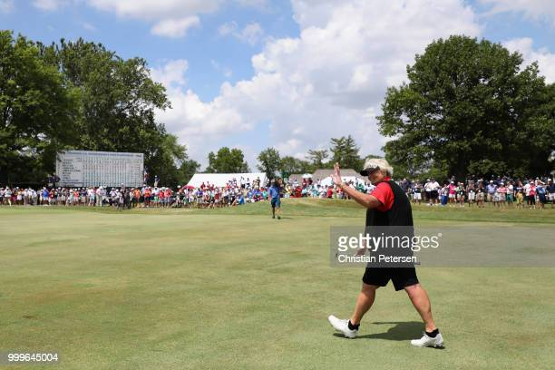 Laura Davies of England waves to fans as she walks up to the 18th green during the final round of the US Senior Women's Open at Chicago Golf Club on...