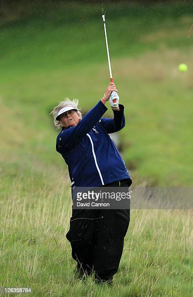 Laura Davies of Europe hits from the rough during the singles matches on day three of the 2011 Solheim Cup at Killeen Castle Golf Club on September...