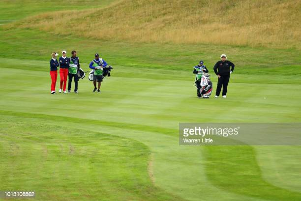 Laura Davies of Great Britain takes her second shot on hole ten watched by Noemi Jimenez and Silvia Banon of Spain during match 1 of Group A during...