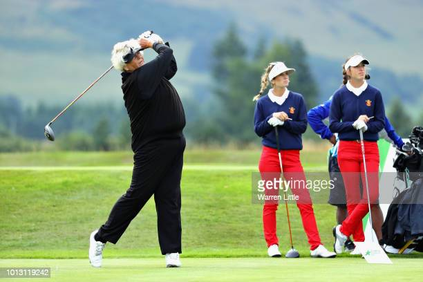 Laura Davies of Great Britain takes her tee shot on hole twelve watched by Noemi Jimenez and Silvia Banon of Spain during match 1 of Group A during...