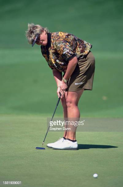 Laura Davies of Great Britain watches her golf ball after putting on the green during the 23rd edition of the Nabisco Dinah Shore golf tournament on...