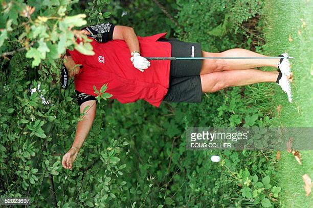 Laura Davies of Ottershaw, Surrey, England takes a drop on the 4th hole after hitting into the woods during the first round of the 1997 US Women's...