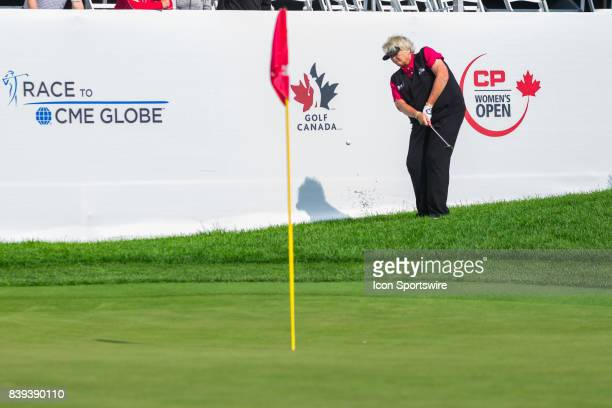 Laura Davies plays a shot from the rough onto the green of the 18th hole during the second round of the Canadian Pacific Women's Open on August 25...
