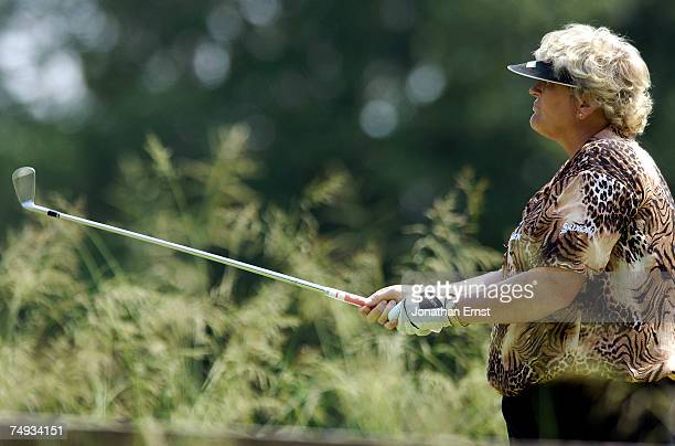 Laura Davies watches her shot from the 8th tee during a practice round prior to the start of the US Women's Open Championship at Pine Needles Lodge...