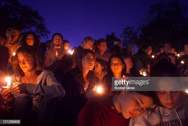 Laura DePeters right and Jennie Perlmutter left roommates at NYU attended the candle light vigil at Washington Square Park in New York City to...