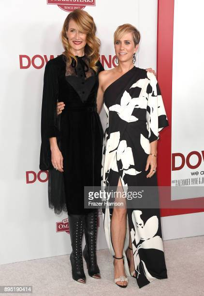 Laura Dern and Kristen Wiig attend the Los Angeles Special Screening of 'Downsizing' at The Regency Village Theatre onDecember 18 2017 in Westwood CA